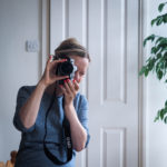 Katya Willems, Instagram trainer, with camera.