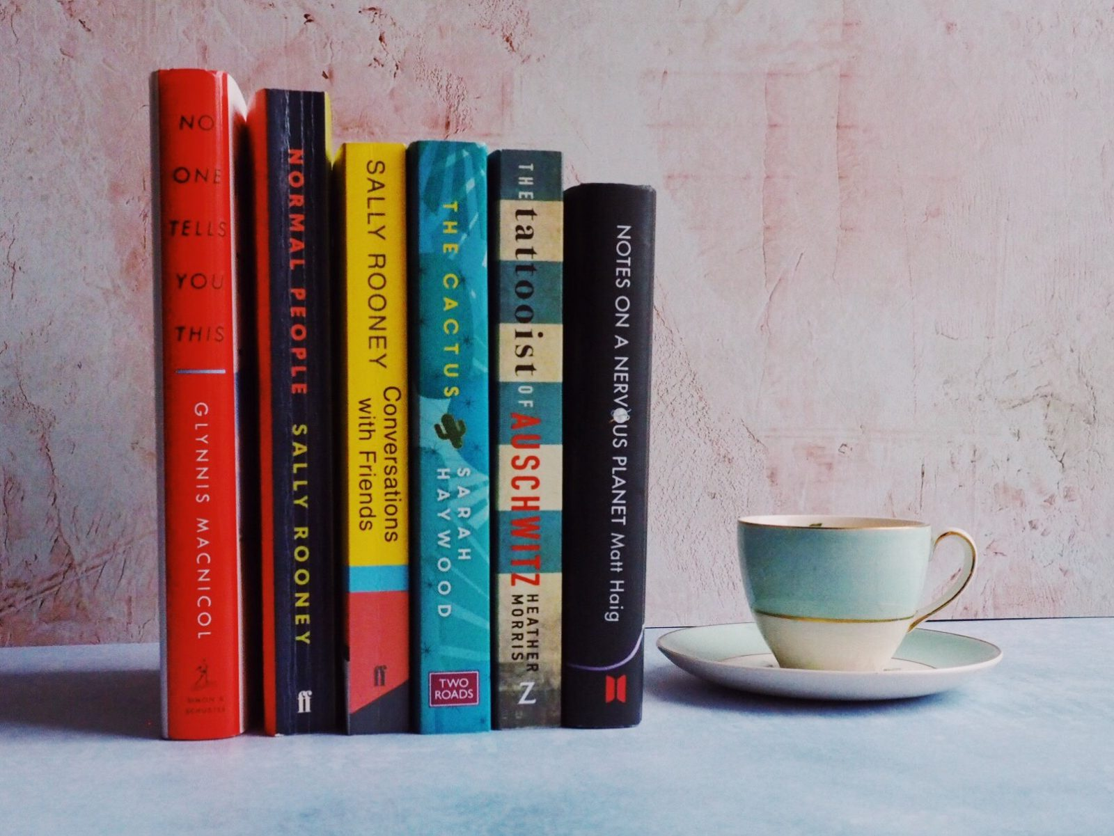 Books and a cup and saucer.