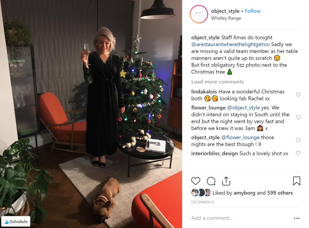Rachael Otterwell of Object Style in front of a Christmas tree.