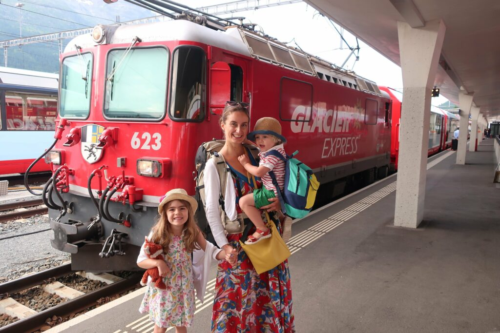 Cathy Toogood and children in front of train in Europe.