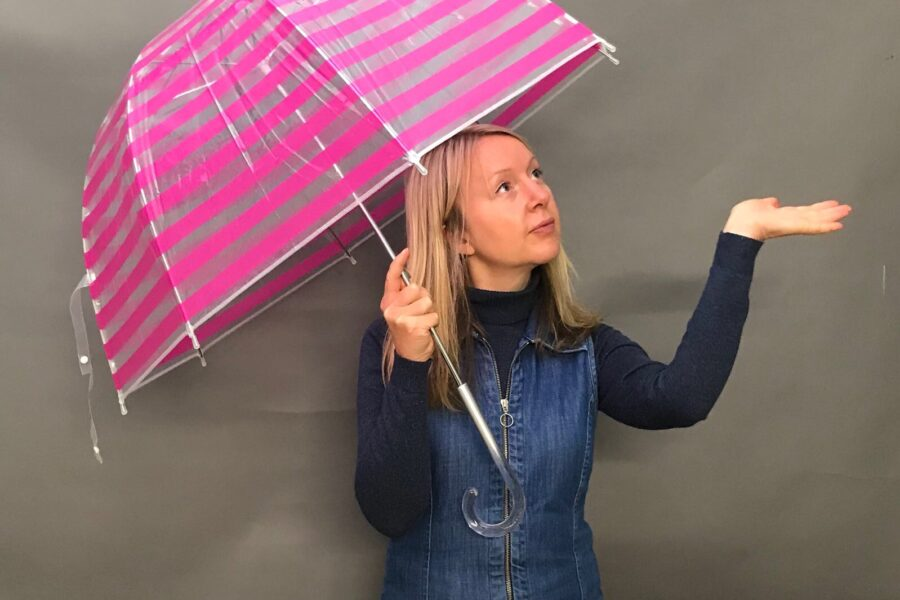 Katya Willems Instagram Trainer with umbrella.