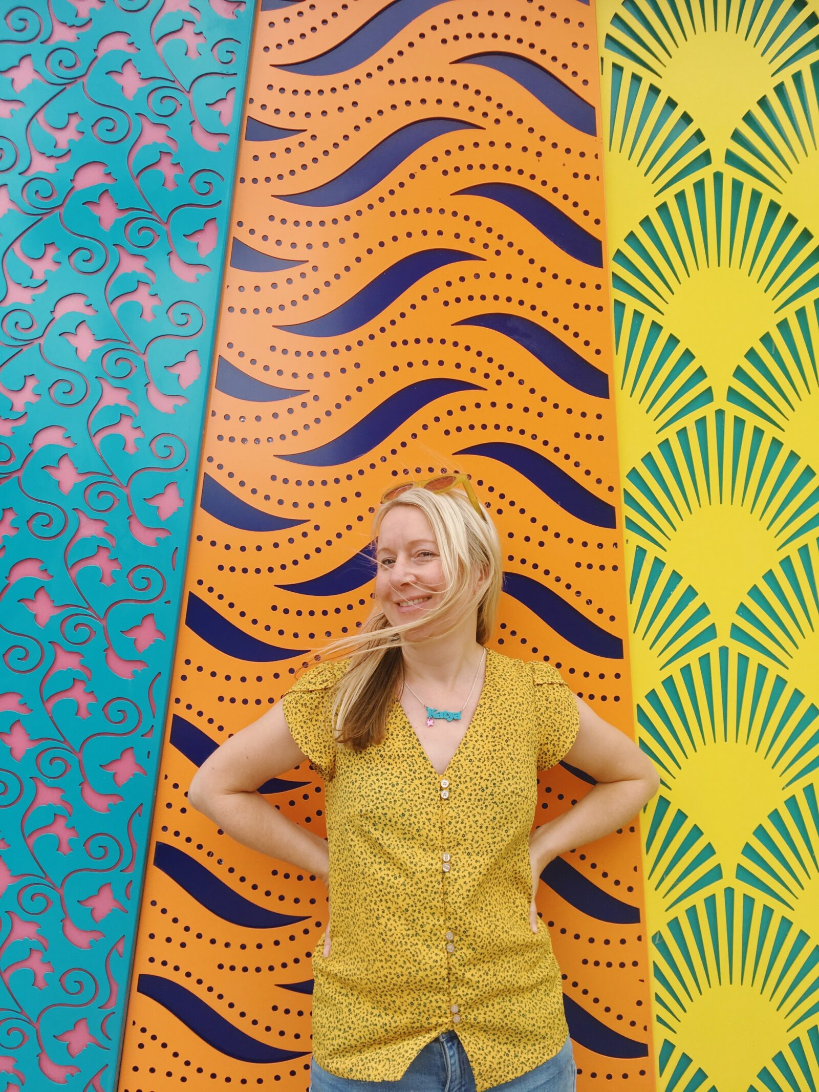 Katya Willems in front of a colourful wall