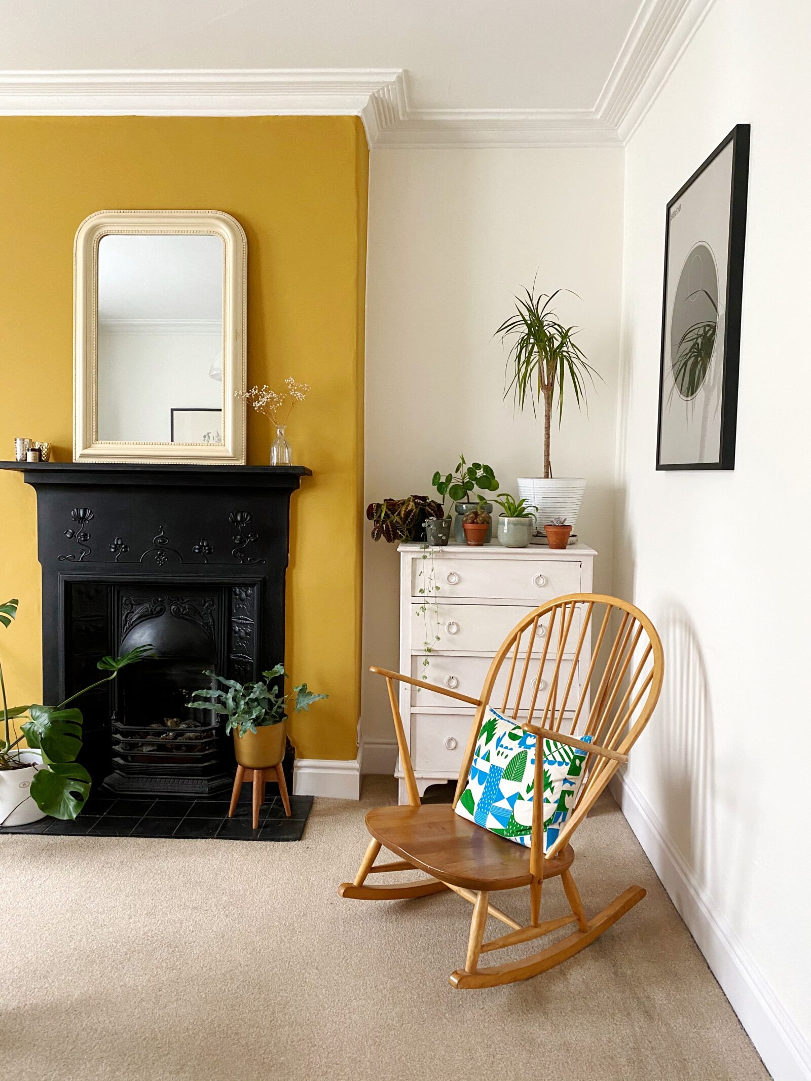 Mustard living Room with rocking chair.