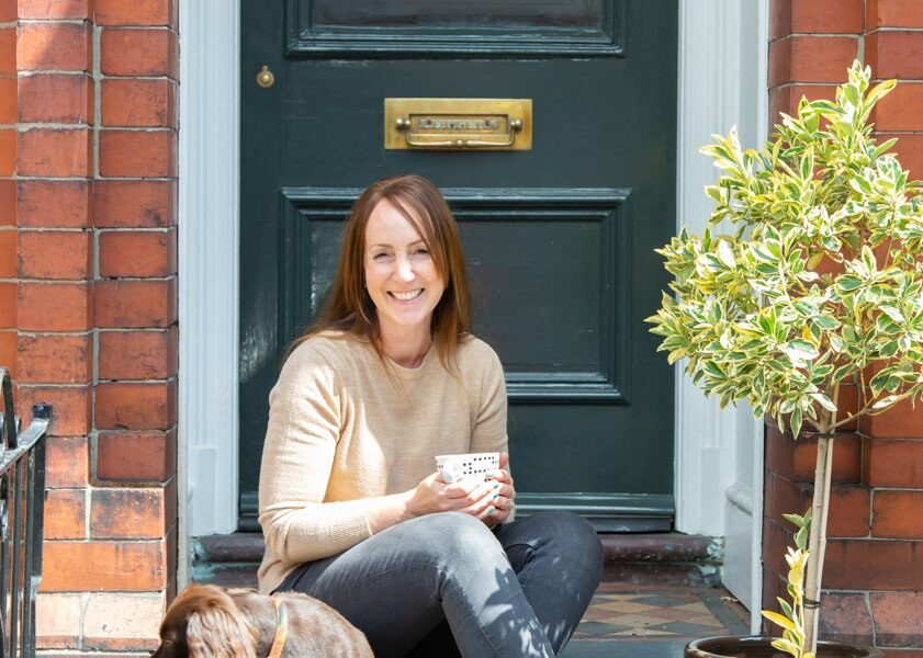 Lucy Burt Interior Designer in front of her house.