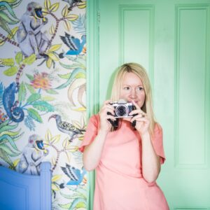 Katya Willems Instagram Expert with camera.