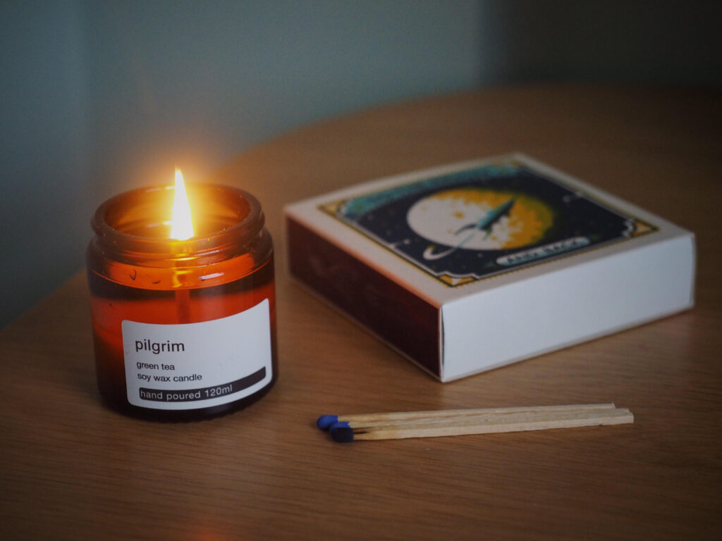 pilgrim green tea candle and matches.